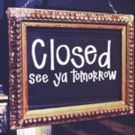 "Shop sign on local community business reading ""closed see ya tomorrow"""