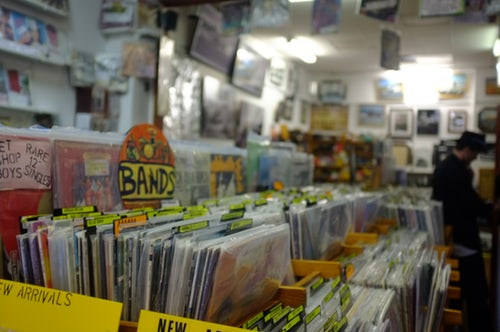 Local record store with thousands of vintage and brand new records stacked in viewing boxes